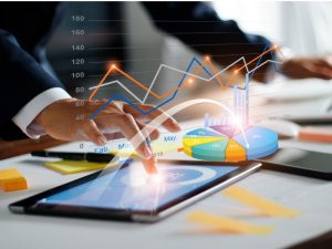 businessman-using-tablet-and-laptop-analyzing-sales-data-and-economic